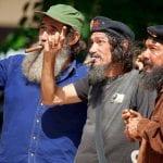 Einheimische als Fidel und Che Guevara verkleidet in Kuba